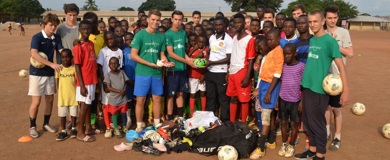Projects Abroad volunteers taking part in soccer coaching for high school students in Ghana donate new equipment to a local team.